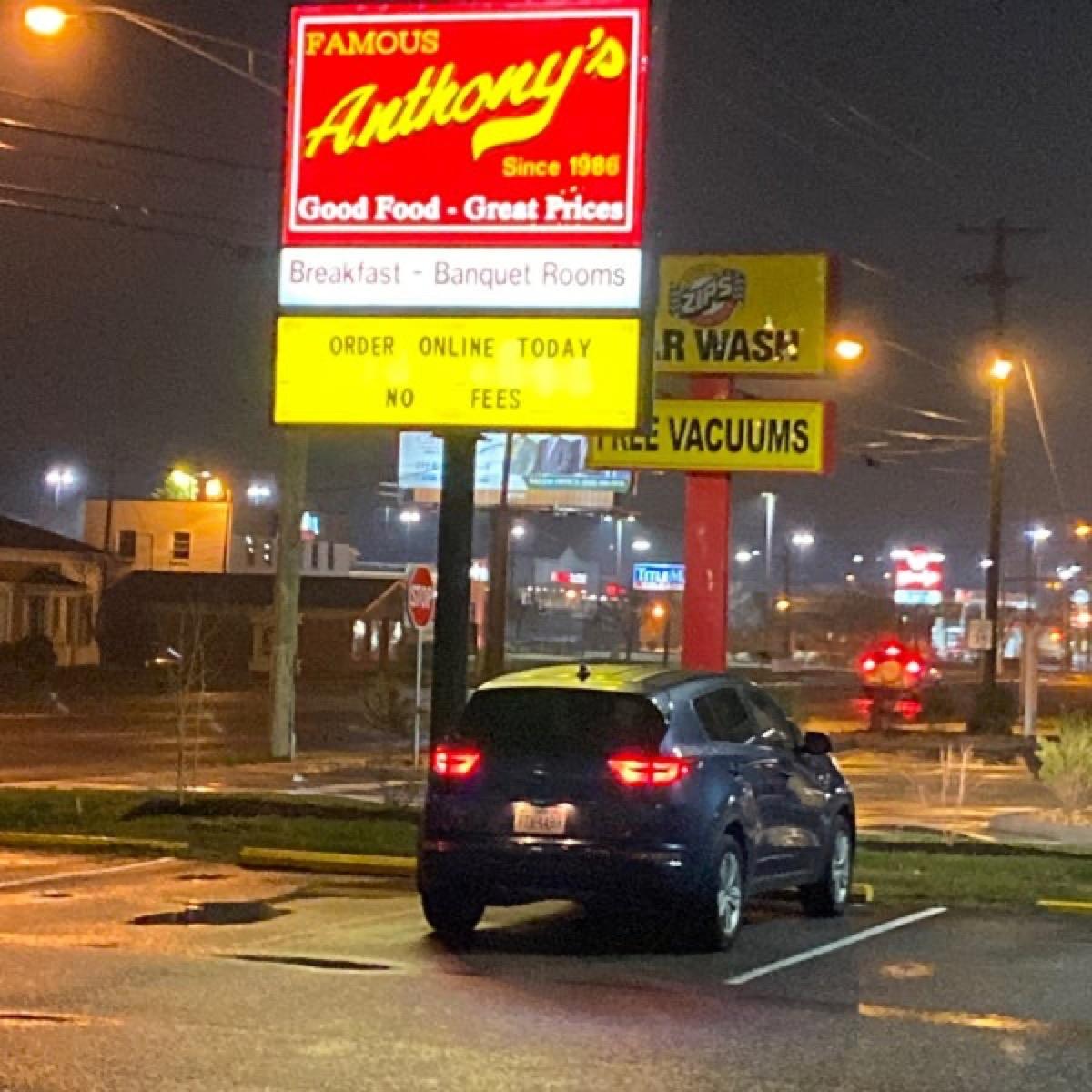 exterior shot of illuminated sign at famous anthonys restaurant at night