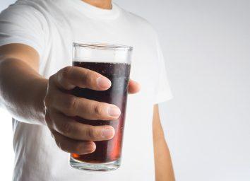 man holding soda