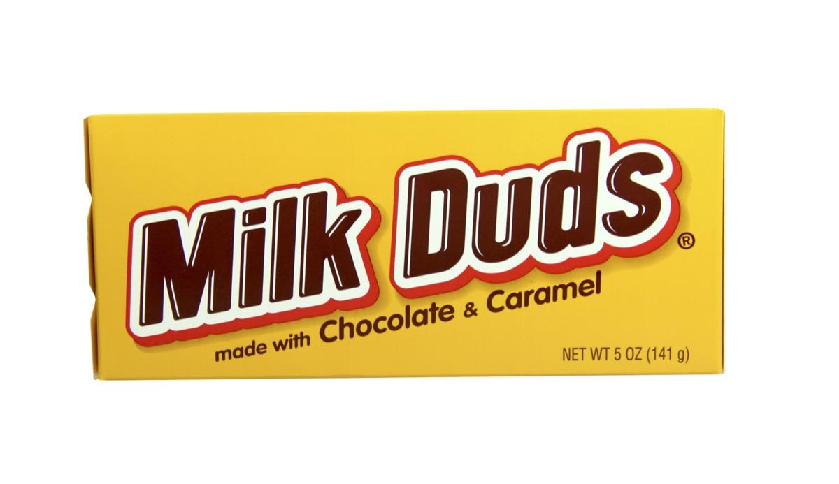 box of milk duds on white background