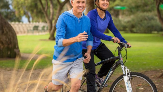Older couple running cycling