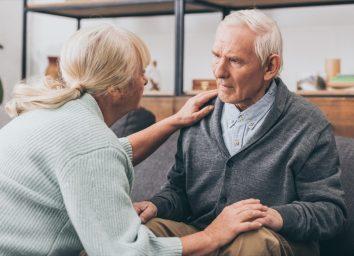 older man with dementia speaking to caregiver