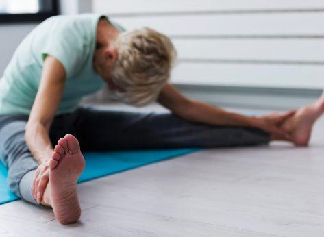 older woman stretching yoga