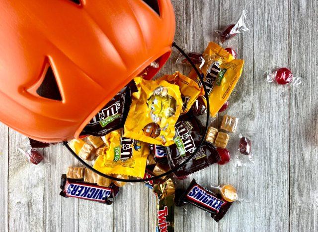 plastic pumpkin spilling out halloween candy