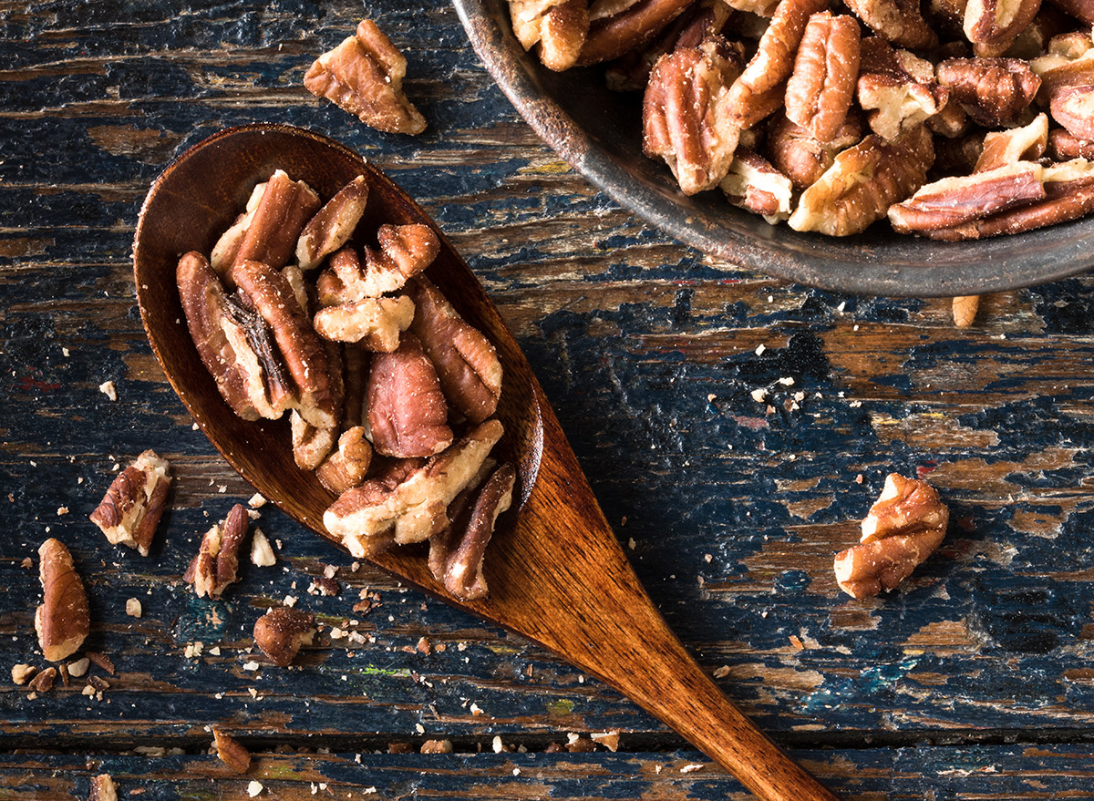 spoon of pecans on a table