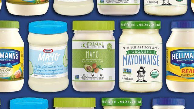 various jars of mayo on blue background