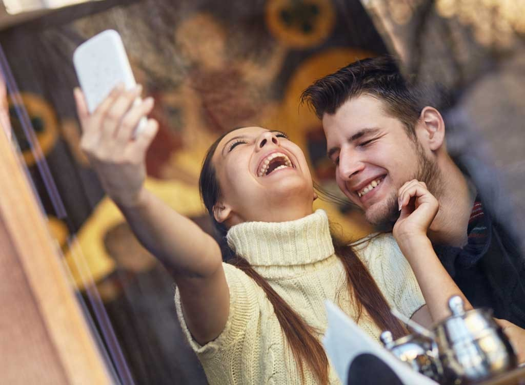 Couple taking selfie - how to lose weight after 30