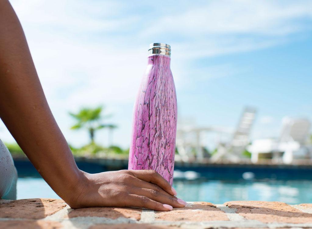 swell water bottle poolside