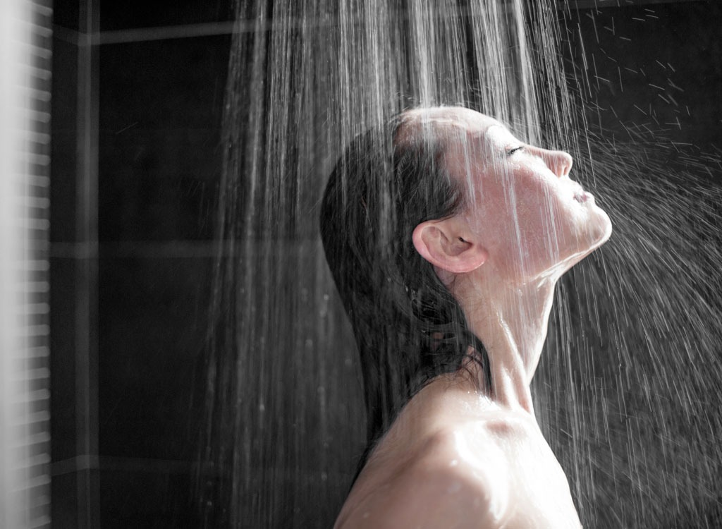 Woman showering - how to lose weight overnight