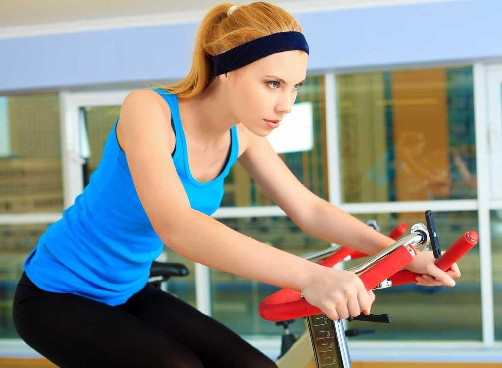 girl on gym bike