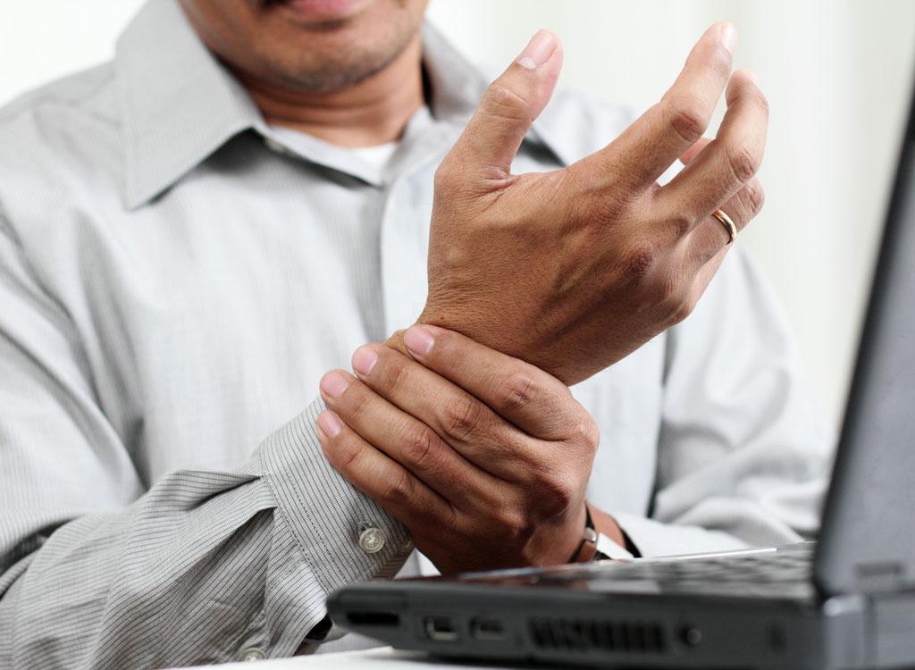 Man sore holding wrist