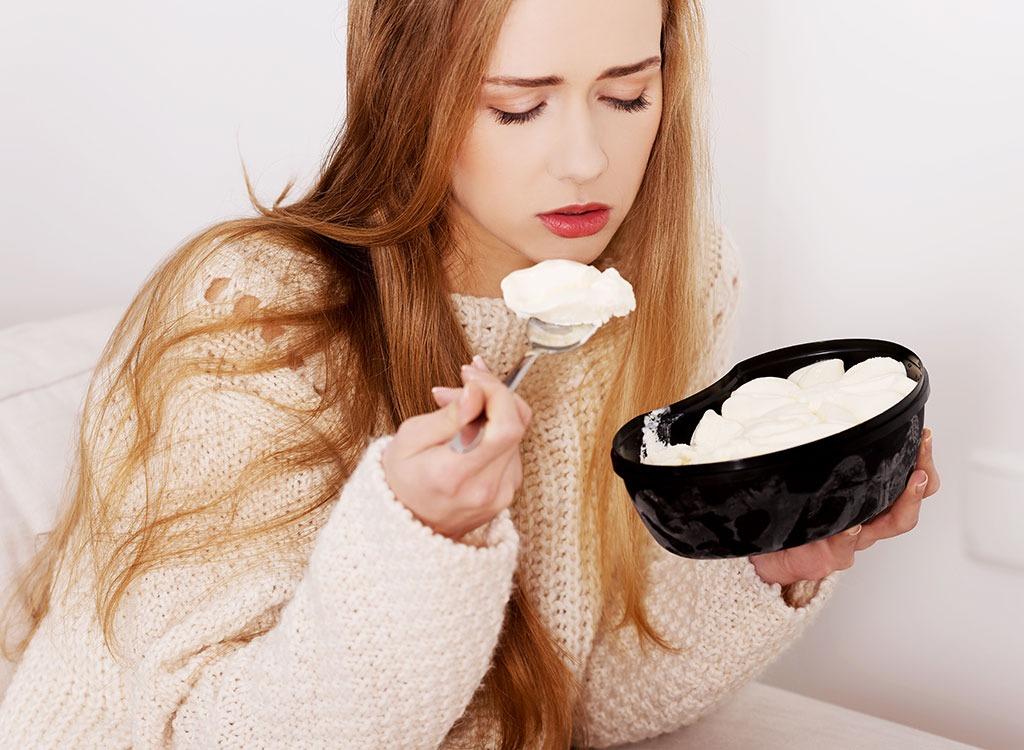 upset woman eating ice cream