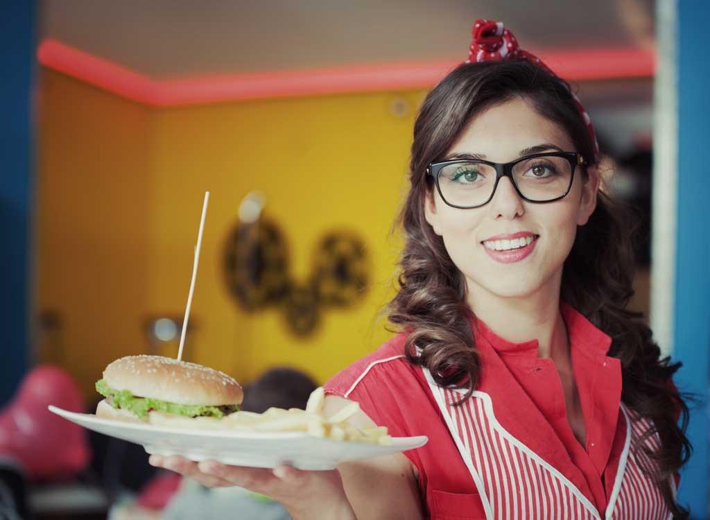 retro waitress serving burger