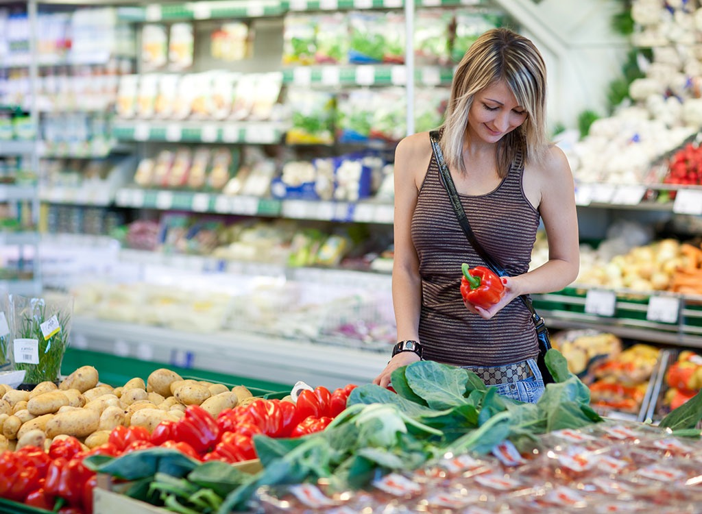 woman buying produce at grocery store