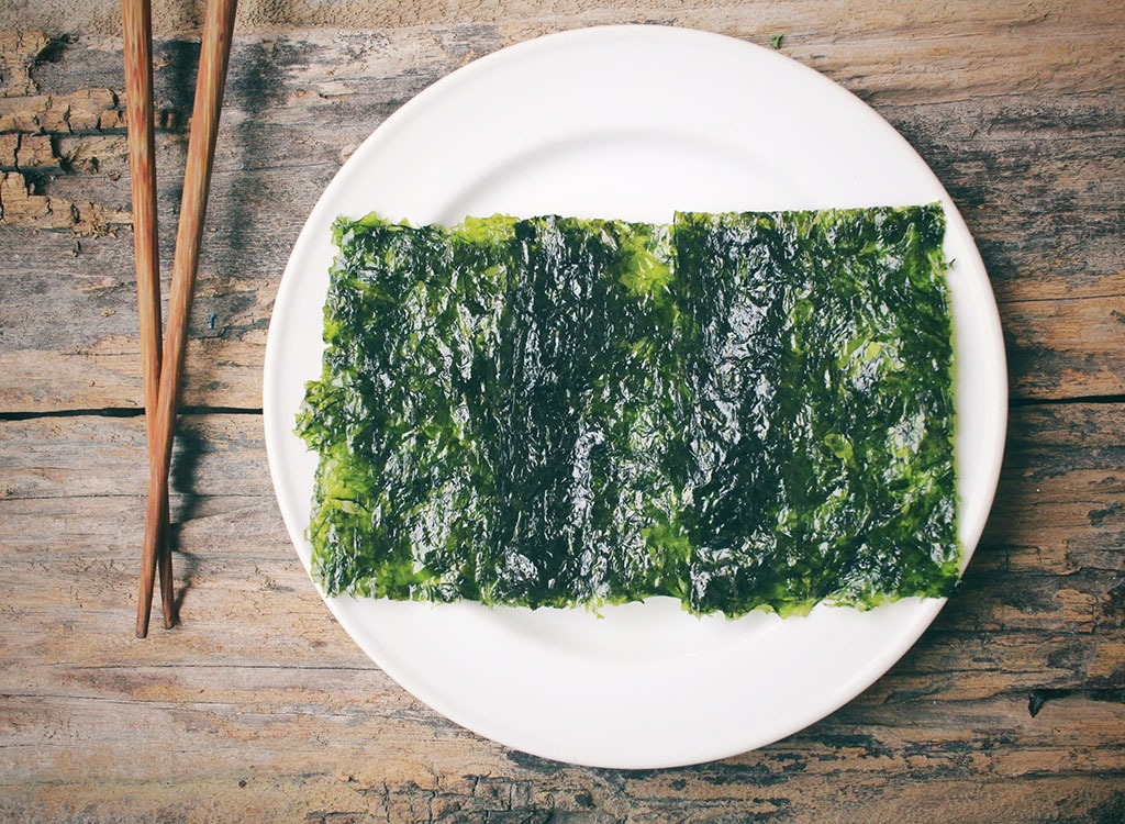 seaweed cracker on white plate with chopsticks