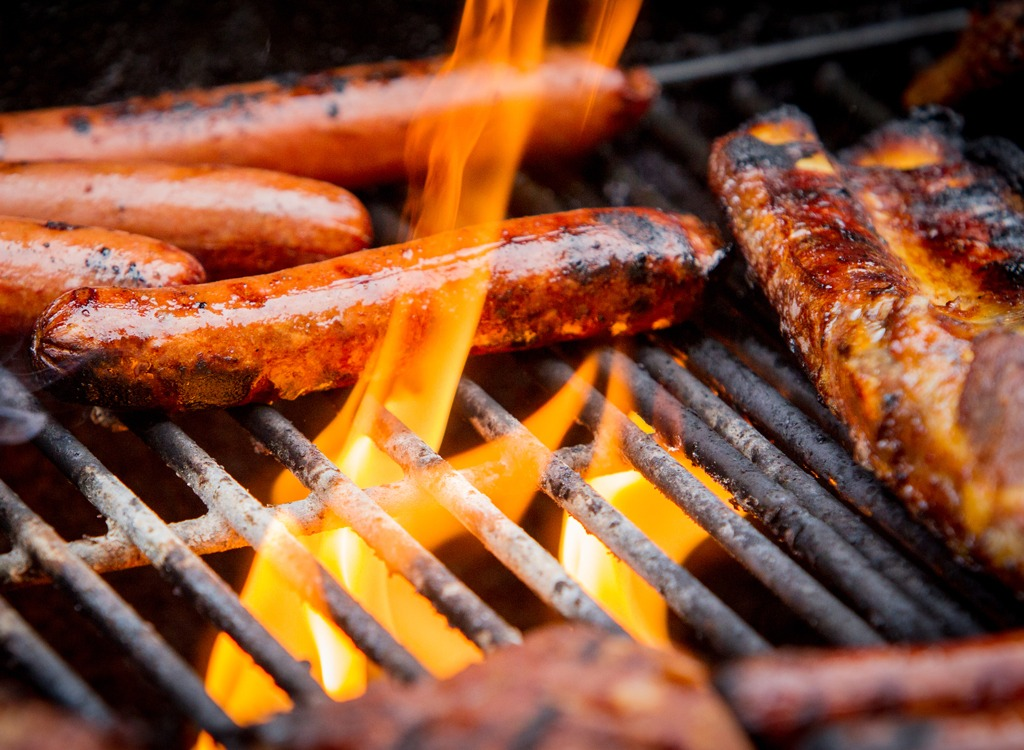 Sausage and hot dogs on grill