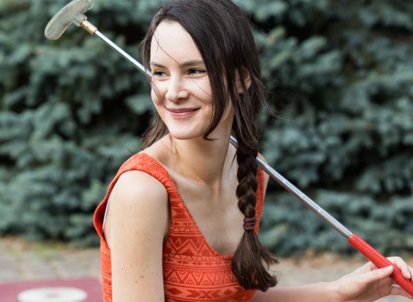 Woman mini golfing