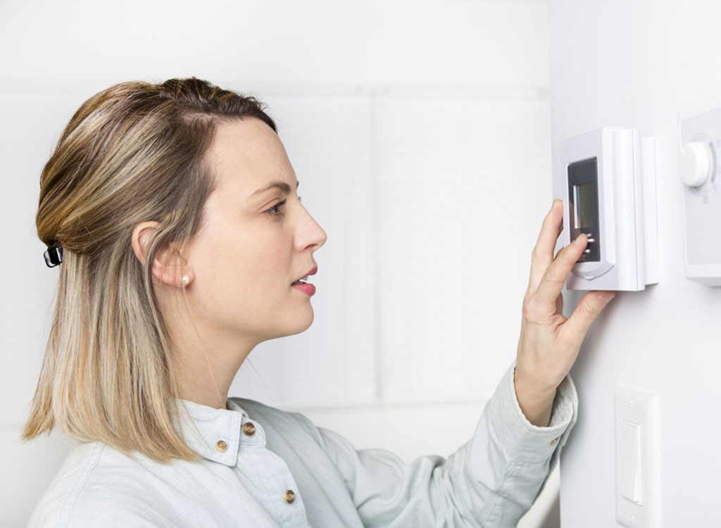 woman and thermostat
