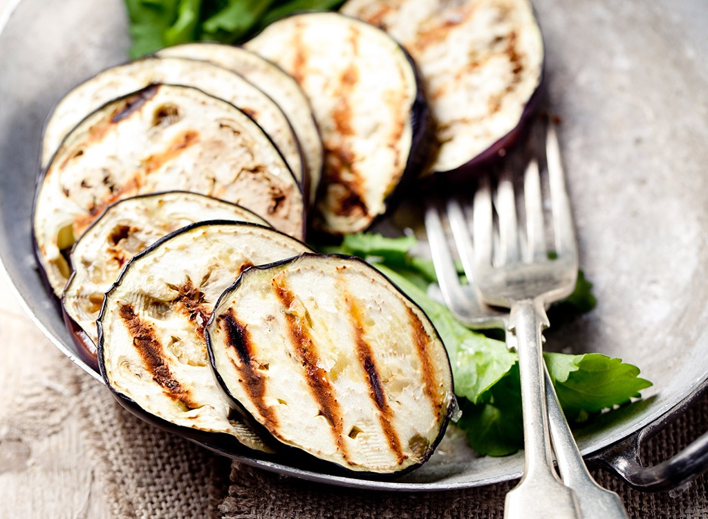 Grilled eggplant with fork