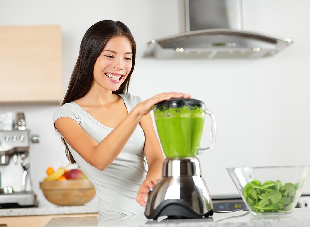 Woman making smoothie