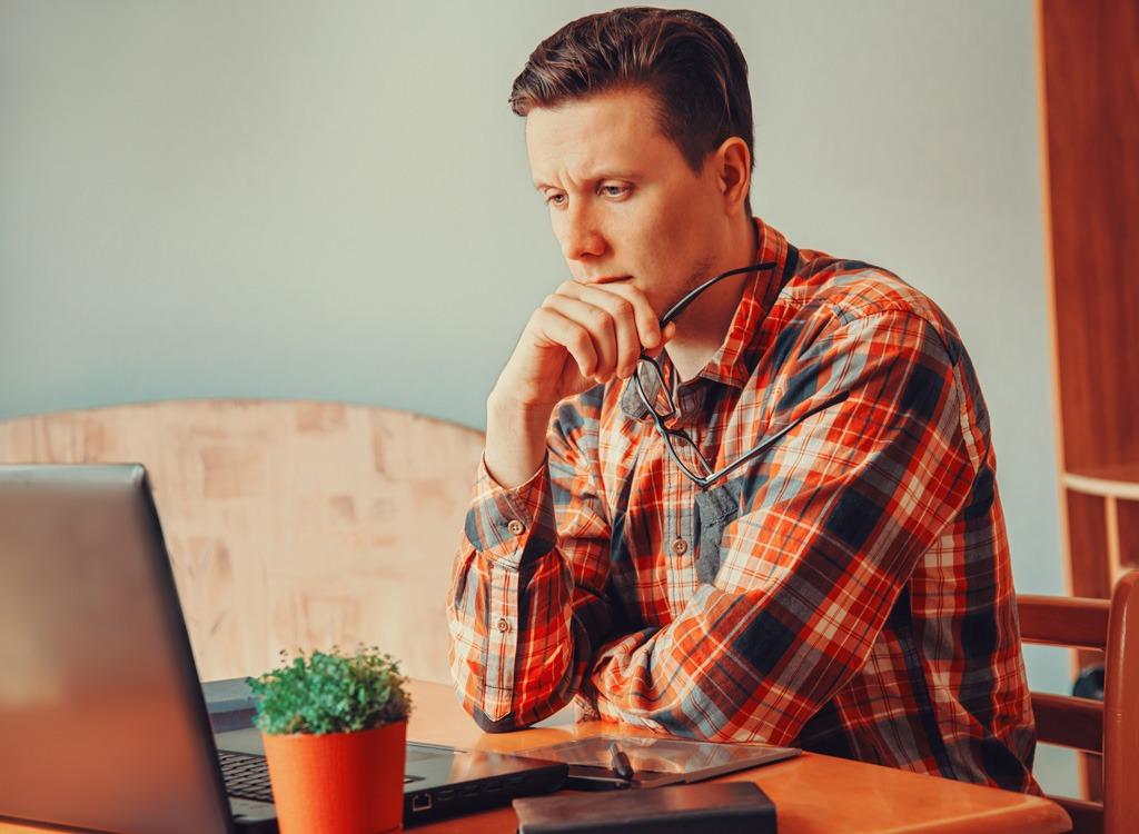 Man thinking at a computer