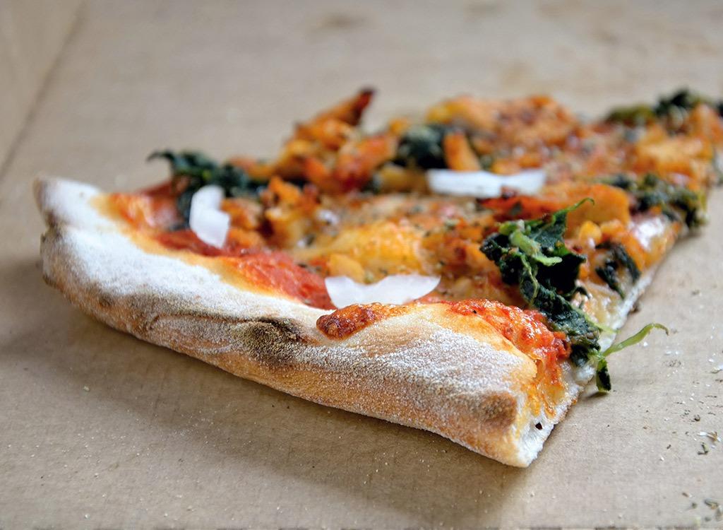 Pizza slice leftover in box