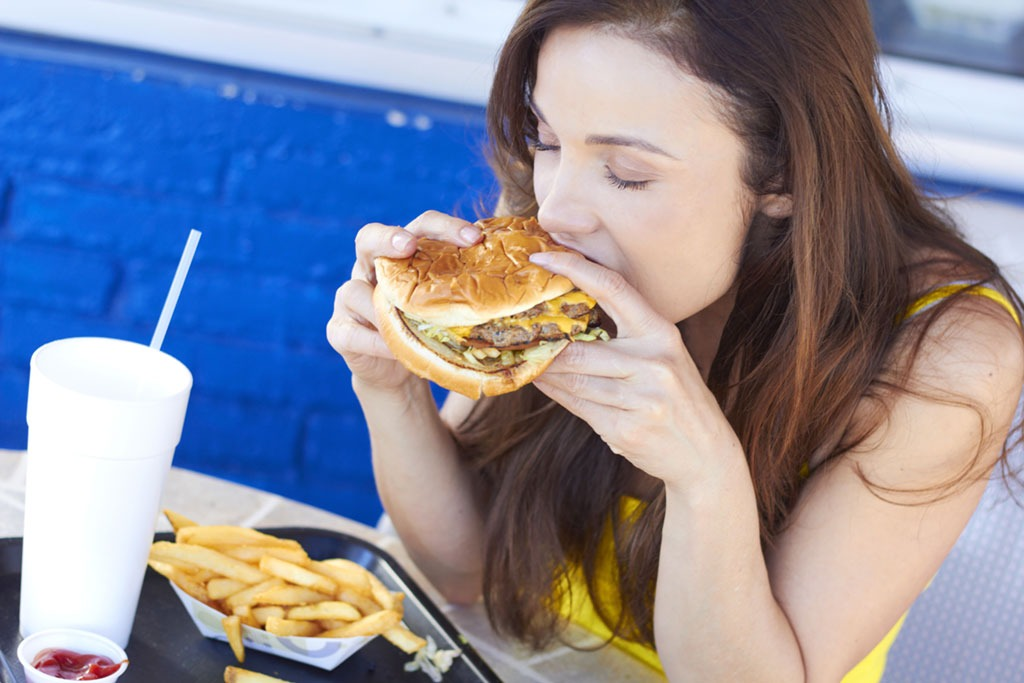 girl eating burger and fries