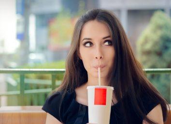 Girl sipping soda