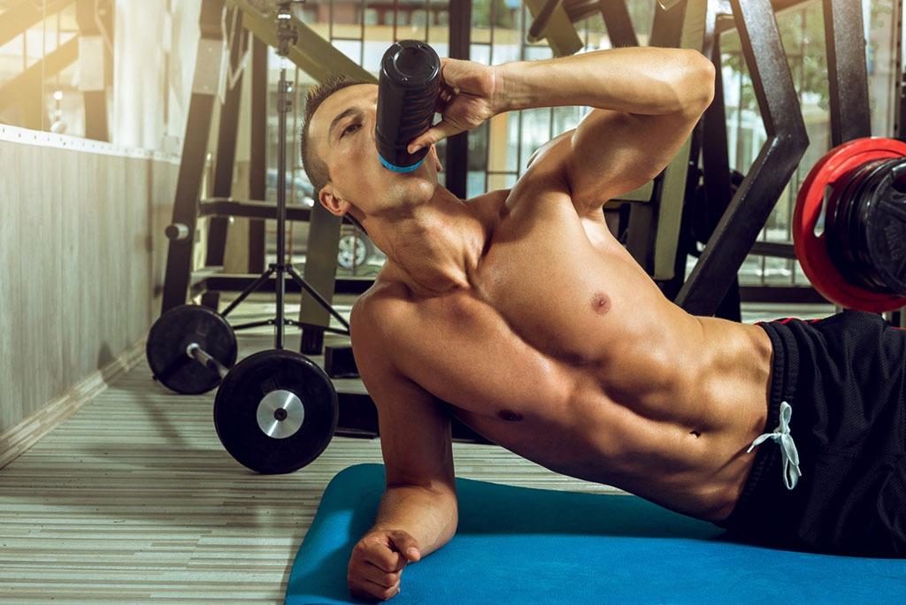 man drinking protein shake gym