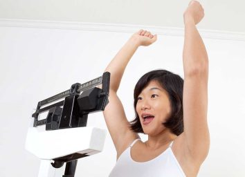 Woman success scale weight loss