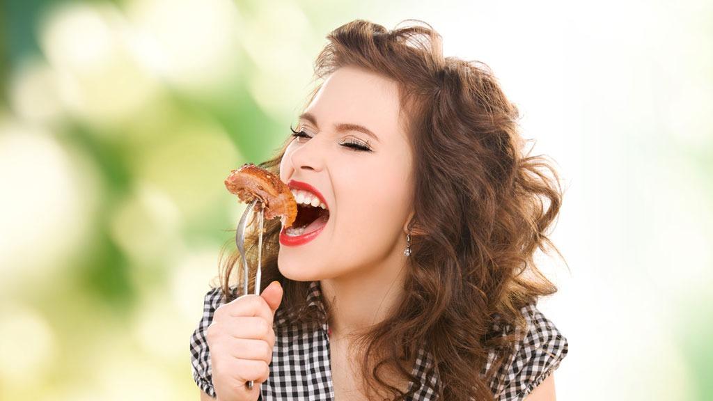 Worst vacation habits woman eating food