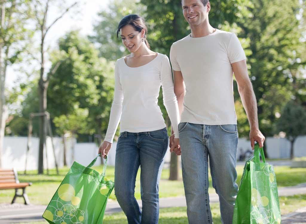 Man woman walking shopping bag