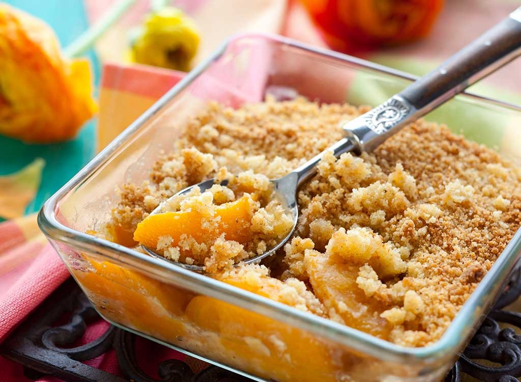 serving of peach cobbler with spoon