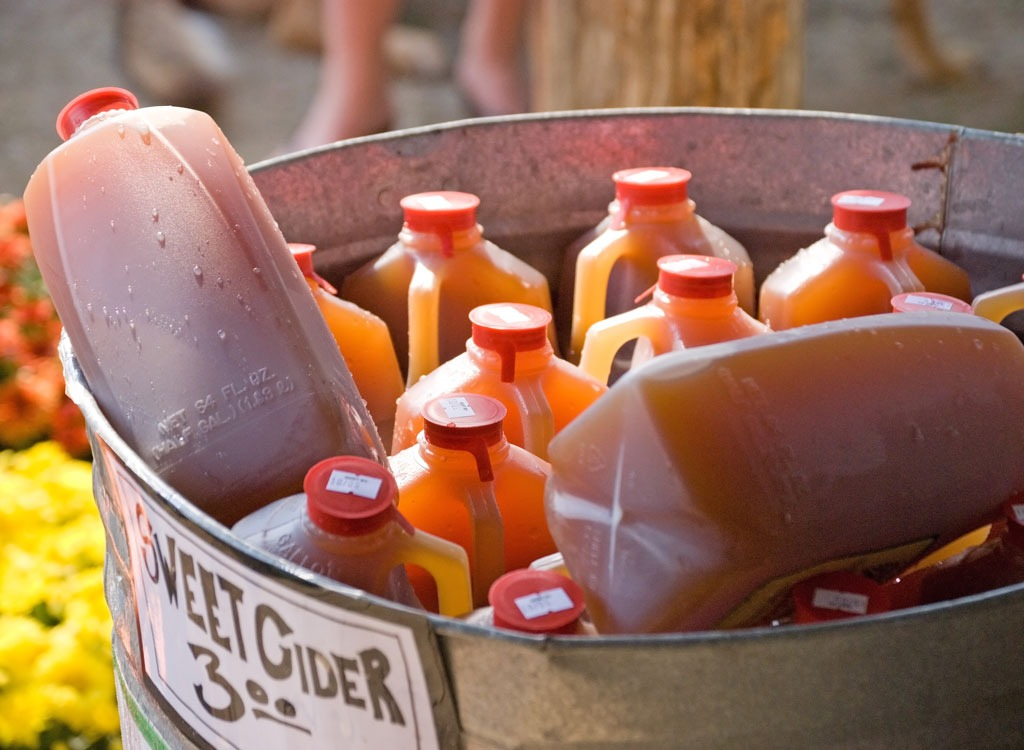 Apple cider jugs in a tub