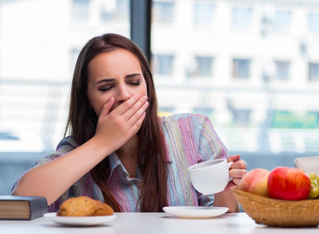 Sleepy woman eating