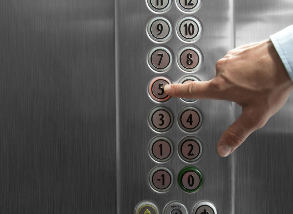 Pressing elevator button