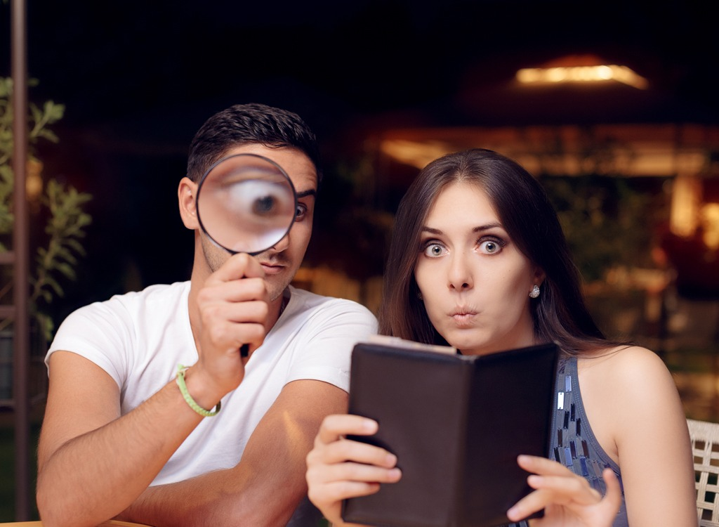 Couple looking at restaurant bill