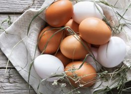 Brown and white eggs in basket