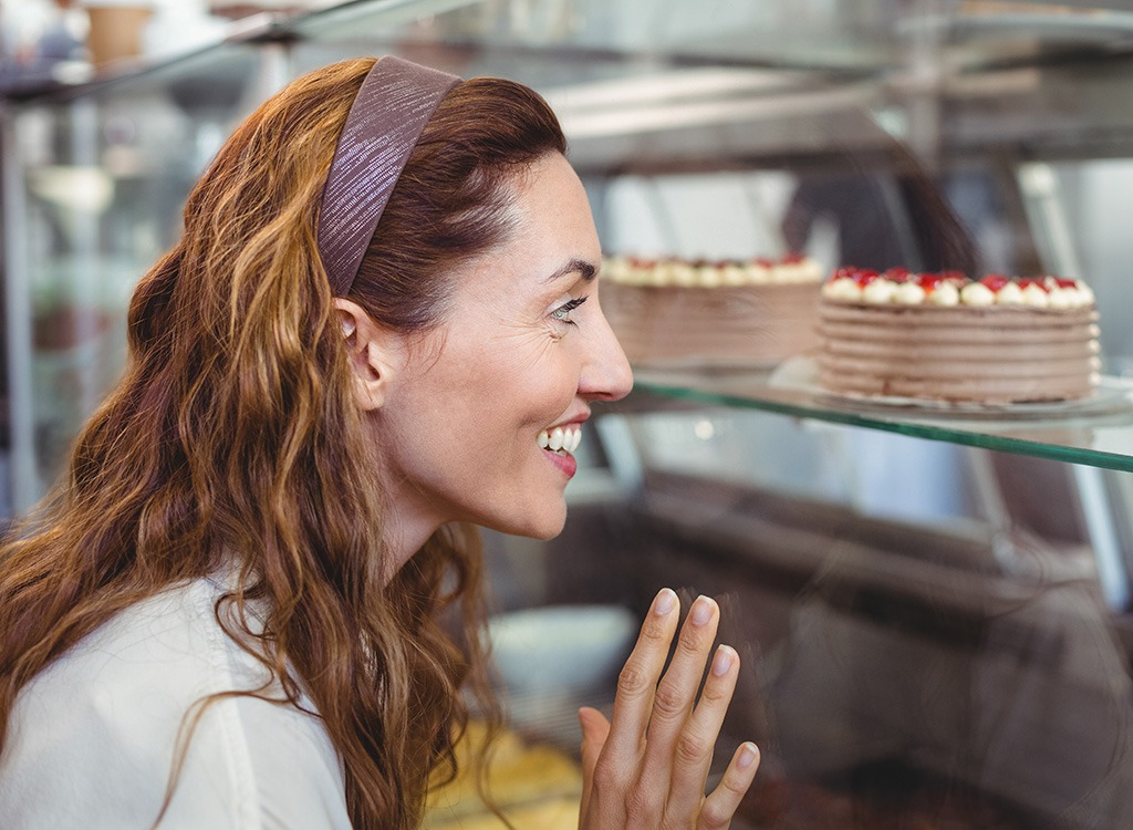 woman looking at desserts - pb2