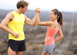Fit man and woman high five