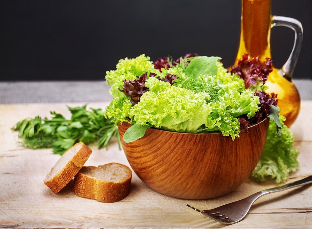 Green salad in wooden bowl - foods that make you poop