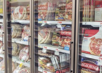 frozen pizza aisle at the grocery store