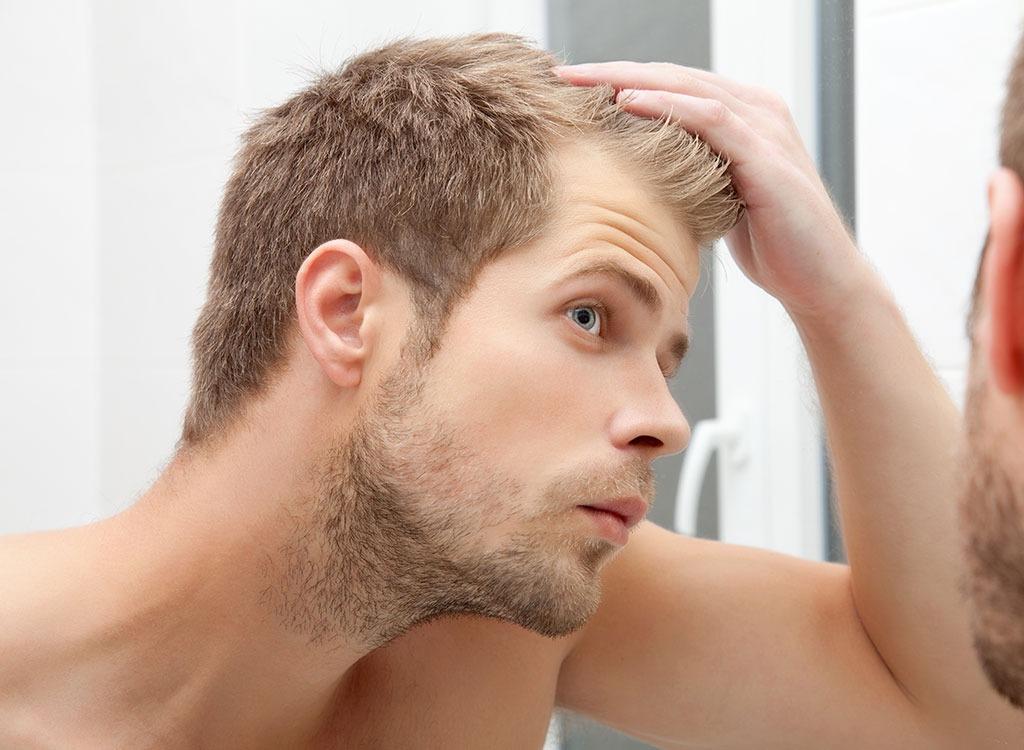 Man looking at hair