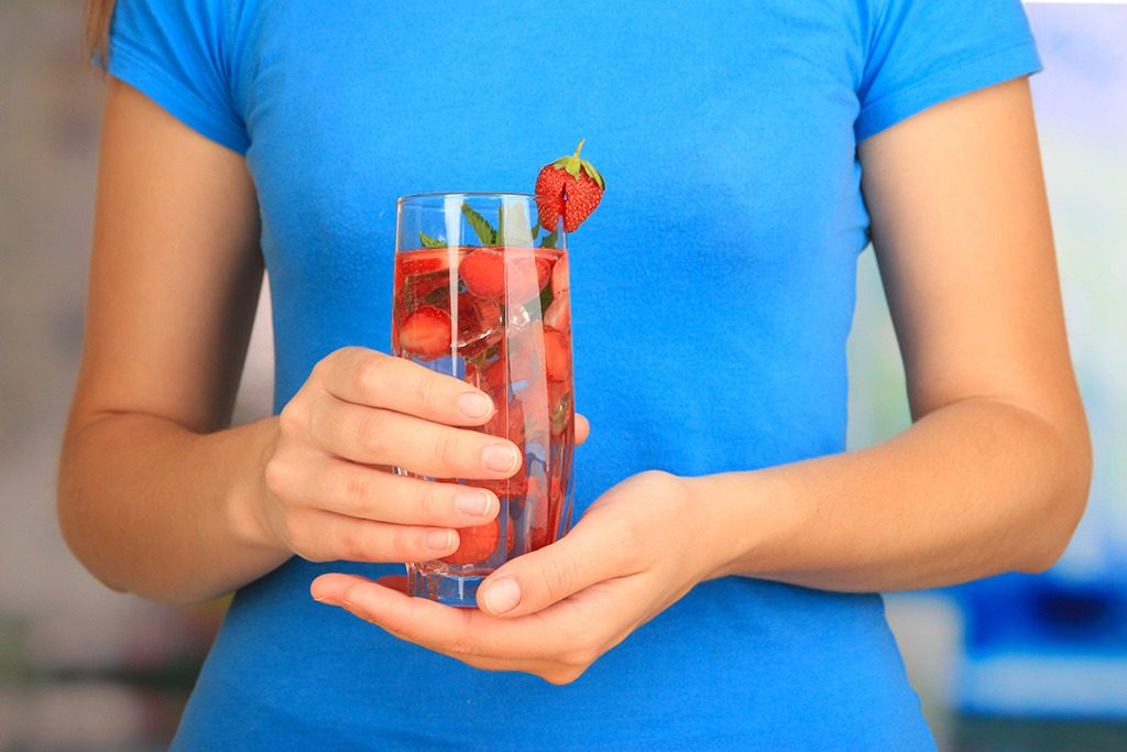 woman holding fruit water