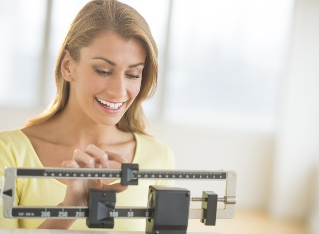 Motivational tips women on scale