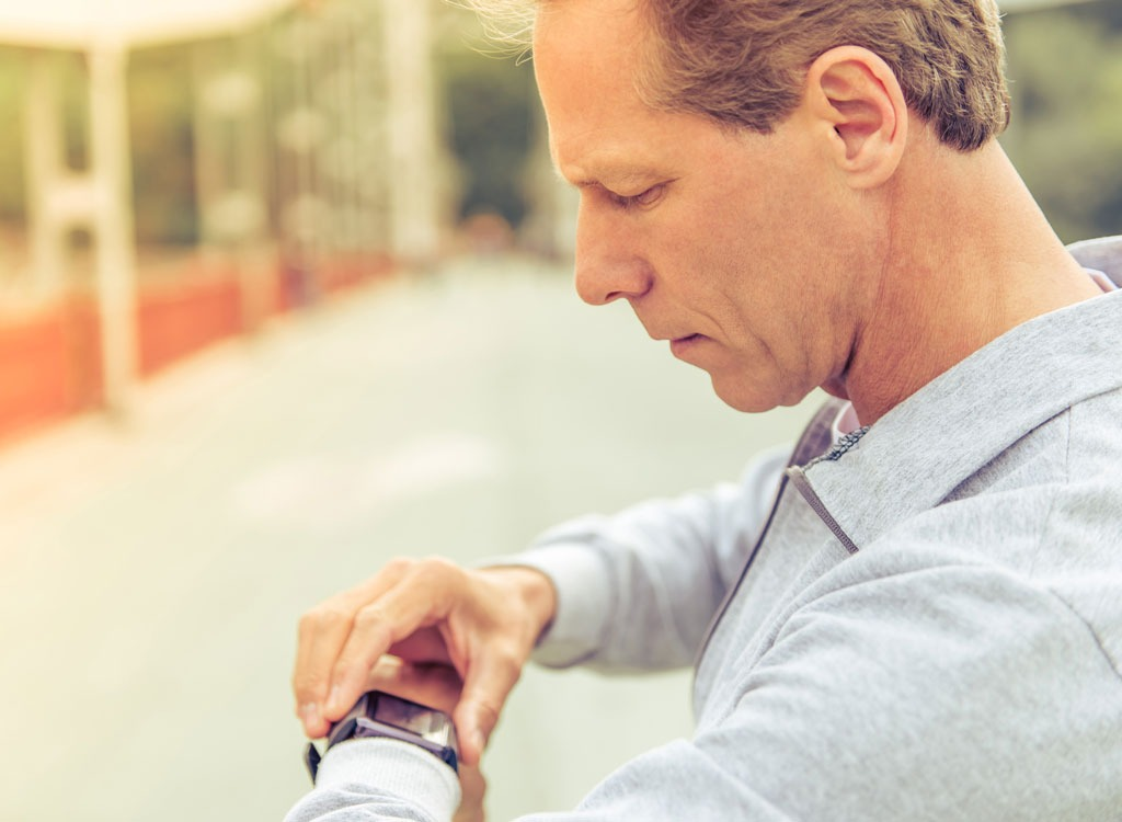 fitness man looking at watch