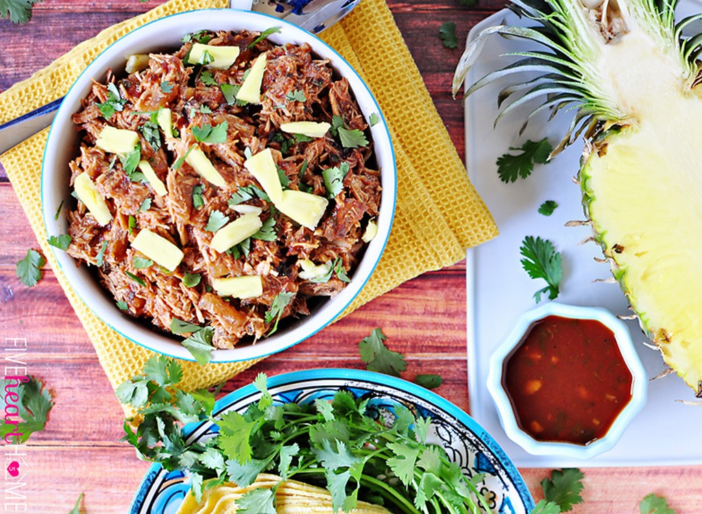 pineapple pulled pork with halved pineapple and salsa