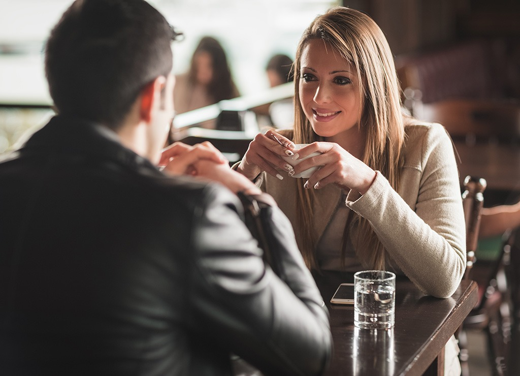 Two people talking at a restaurant