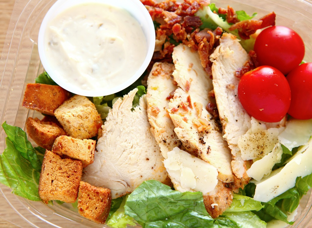 grilled chicken salad in plastic to-go container