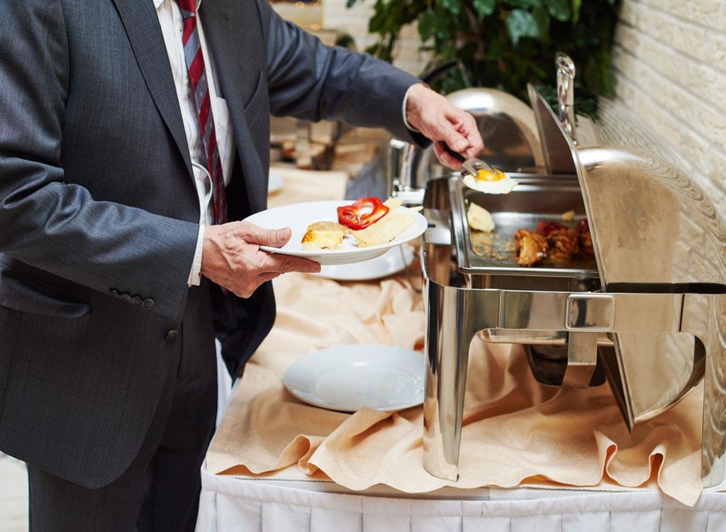 Hotel buffet food man in suit