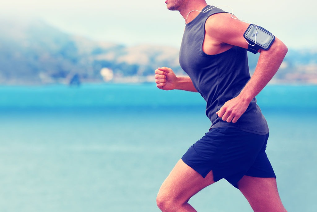 fit man running with music